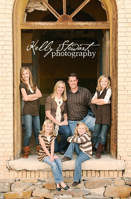 cool pose for families with older children - like the idea of a door or window to frame