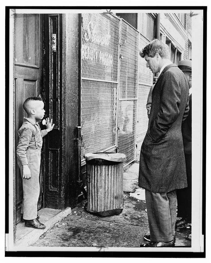 From photographer Dick DeMarsico:  Senator Robert Kennedy discusses school with young Ricky Taggart of 733 Gates Avenue, Bedford-Stuyvesant, Brooklyn    February 4, 1966