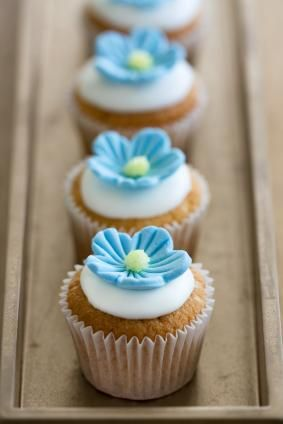 Cupcakes with blue fondant flowers
