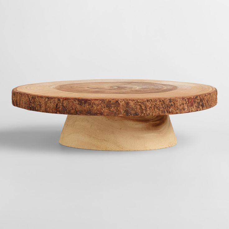 A sensational addition to the dining table, this stand gives your culinary creations extra height for an unforgettable presentation. The natural bark detail and exposed wood grain is extra enticing! www.worldmarket.com #WorldMarket Easter Entertaining