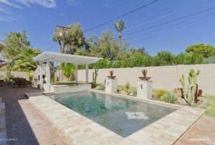 Southwestern Swimming Pool with Pool with hot tub, Fence, outdoor pizza oven, exterior tile floors