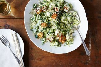 Brussels Sprouts Caesar - Thinly shaved Brussels sprouts have a discernible flavor that stands up to and complements the lemon, garlic, and Parmigiano flavors of the Caesar dressing. food52.com/recipes/39327-brussels-sprouts-caesar