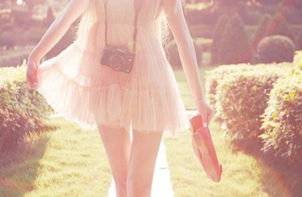 Cute pink tulle dress, red ballerinas, camera and sunshine. Perfect photo.