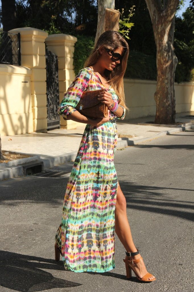 Maxi dress in floral hues with long sleeves and a thigh high split, perfect for spring or summer