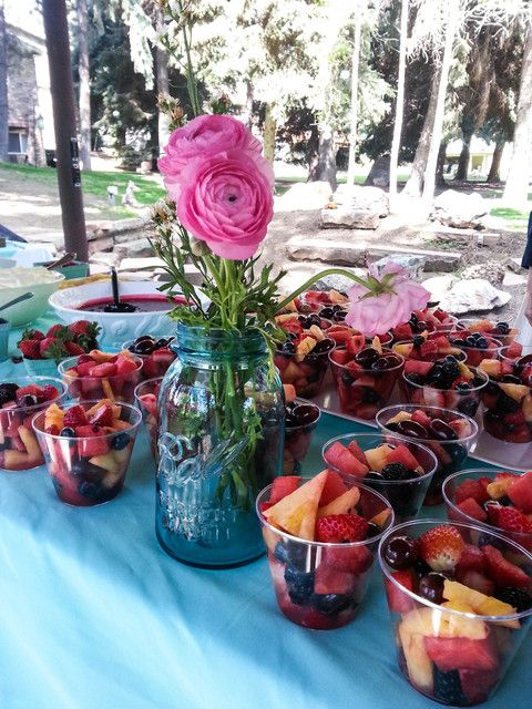 Fruit cups and flowers at a rustic Baby Shower!  See more party ideas at CatchMyParty.com!