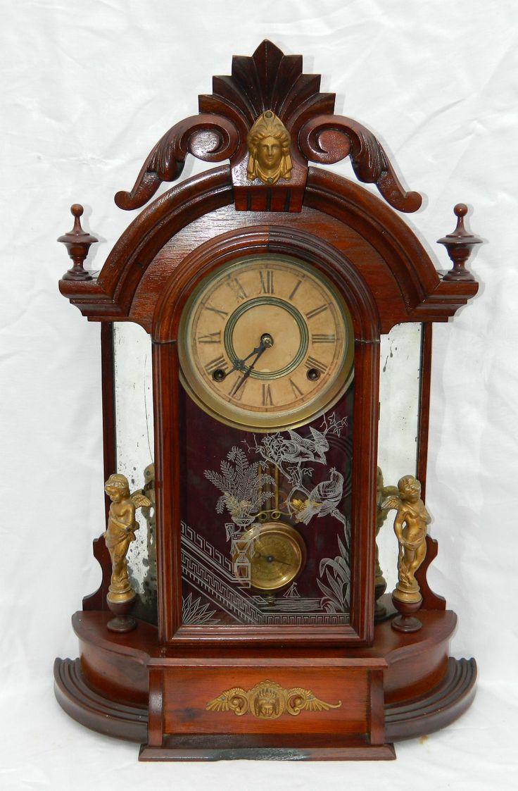 Antiguo relojl Victoriano de Nogal WM. L. GILBERT OCCIDENTAL espejo lateral . Reloj de la chimenea