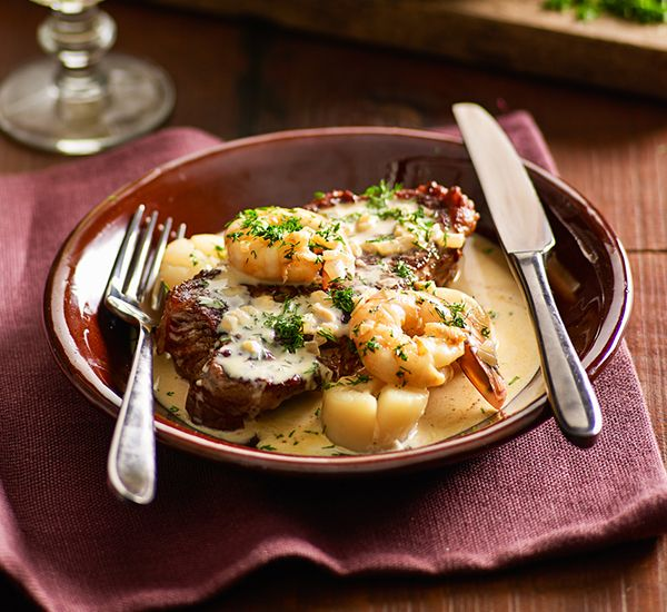 Surf and turf: Tender prawns, scallops and a creamy dill sauce turn a succulent steak into this pub-grub favourite.