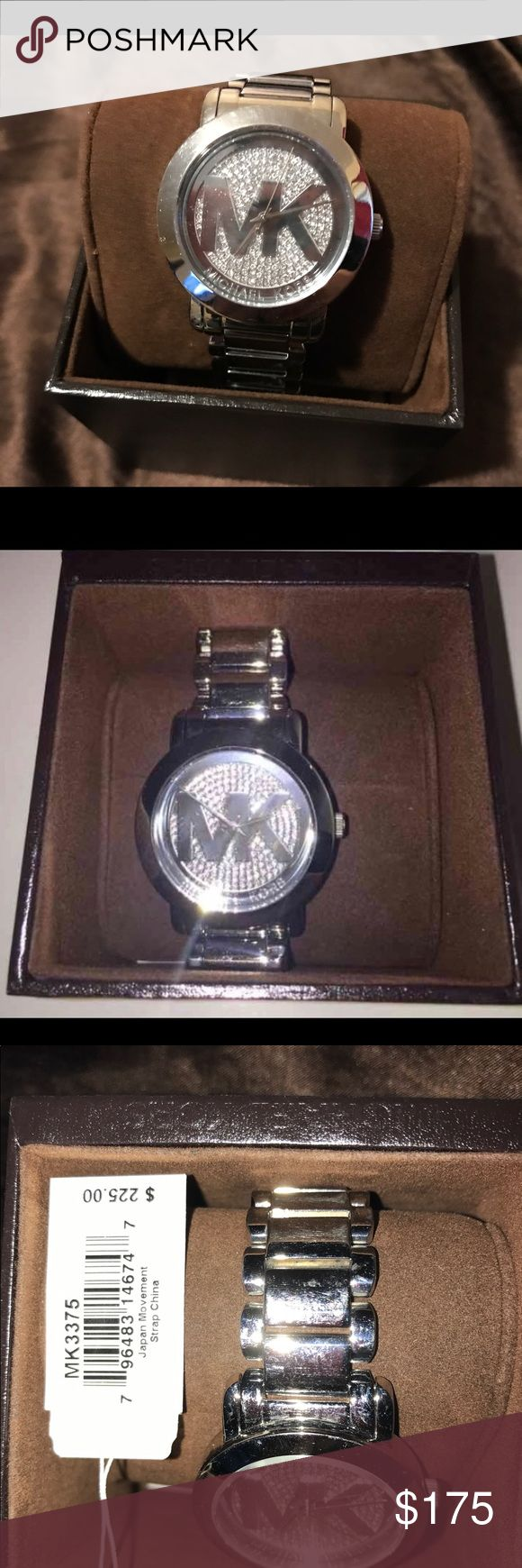MICHAEL KORS WATCH Has some scratches on the back, none on the face comes with the box, good looking watch Michael Kors Accessories Watches