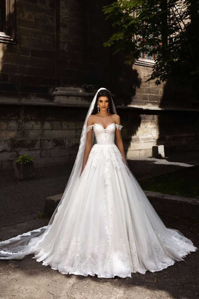 Verona wedding gown. The entire dress carries fairytale grace, but I'm crushin' on the curling pleated treatment at the bottom, just a gorgeous detail that reveals the designer held this back until it was thought through to the most miniscule component. Follow RUSHWORLD! We're on the hunt for everything you'll love!