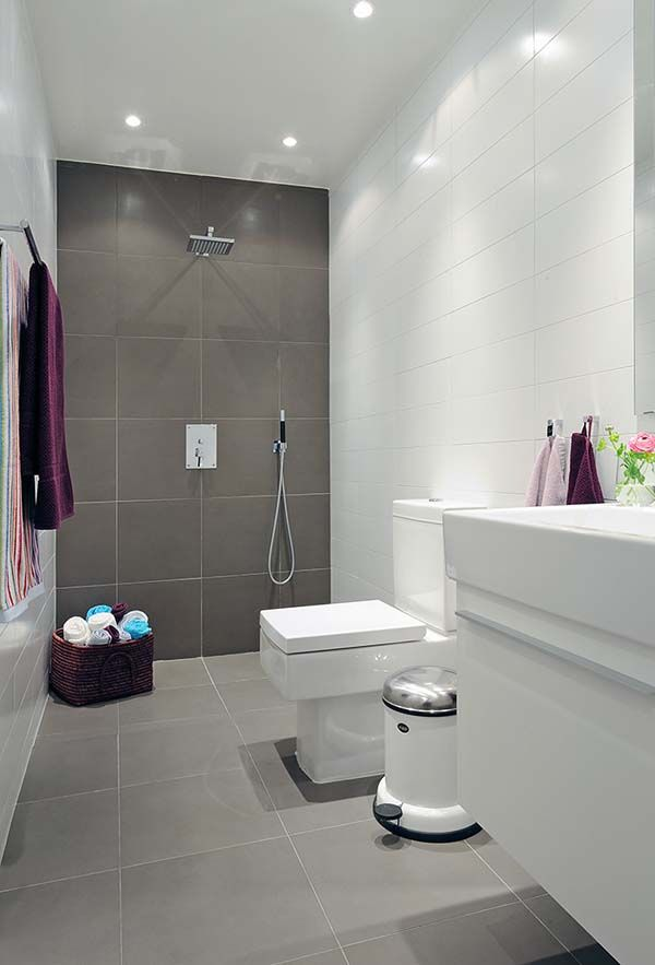 Grey and white large tiles in this simple bathroom