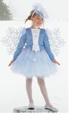 Obviously we would have the bottom be less of a tutu...but this could work.   Snowflake based amazing fascinators...(I can make those)  and then a more simple short dress with white fur trim.