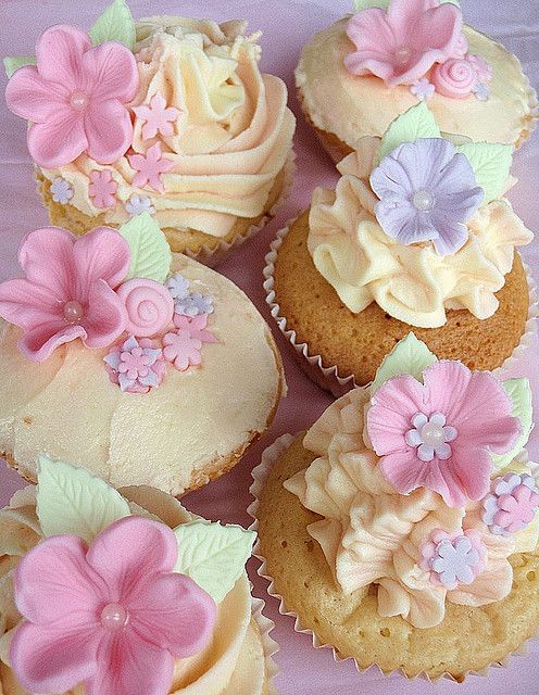 FAIRY CAKES: White chocolate and raspberry mud cupcakes decorated with white chocolate buttercream and fondant flowers