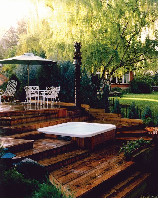 Backyard project idea. Beautiful layered hot tub deck with dark wood — love that the spa is tucked away in the lower deck.
