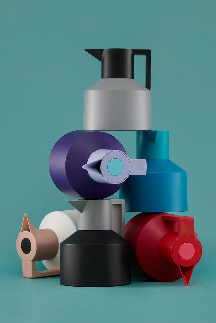 Stylish Geo Vacuum Jug from Normann Copenhagen - available in 6 different color combinations.  Each jug has 3 colors. The jug has a color, the lid has another color, and the push button on the lid a third. The push button on the lid makes it easy to open and close the pot quickly.