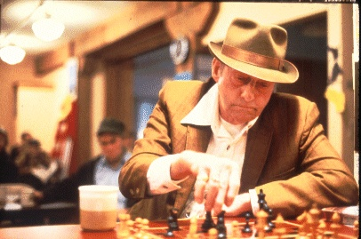 Man playing chess in Pike Place Market, circa 1976