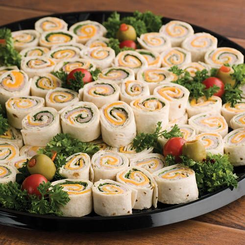 Snack Wraps: Tortilla wraps will satisfy a crowd when filled with flavored cream cheese, smoked turkey breast, black forest ham and cheddar cheese. This is a nice alternative to sandwiches or meat-and-cheese trays.