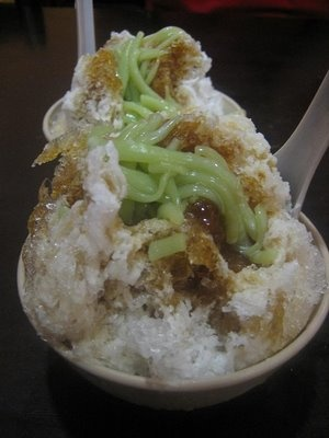 Chendol - A dessert with green noodles in coconut milk, brown sugar and shaved ice.