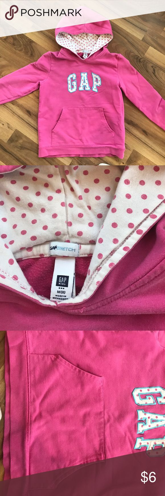 Pink gap sweatshirt This is a pink polka dot sweater purchased from gap. It Is a kids m(8) but runs very small. Fit my 5 yr  old daughter but now she has outgrown it. In fine condition. Has been worn and washed many times but still a good sweatshirt😄 has tiny spot on the back. GAP Shirts & Tops Sweatshirts & Hoodies