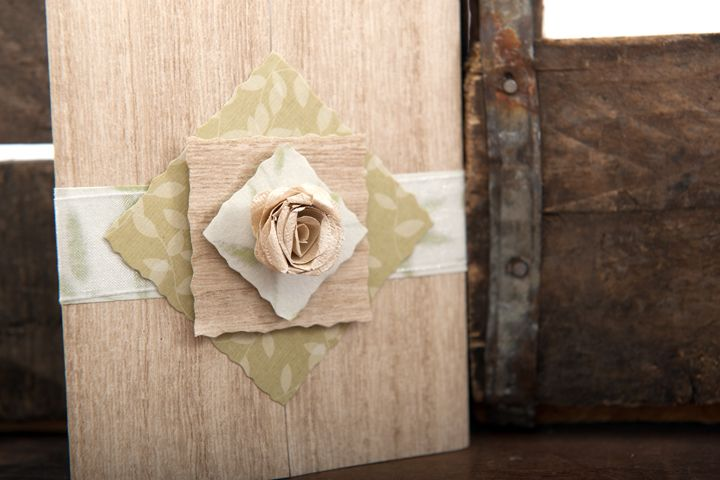 Another nature inspired wedding invitation with wood-grain textured paper, 3D rose and organza ribbon detail.