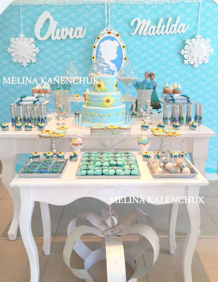 Gorgeous dessert table at a Frozen Fever birthday party! See more party planning ideas at CatchMyParty.com!