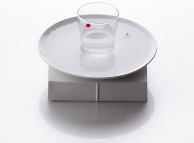 It uses water and magnets to tell time and works with any plate, glass, combination that can hold water. The red ball shows the hours while the white ball shows the minutes. WOW