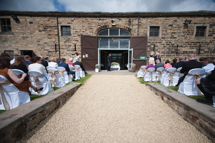 The aisle. Rustic outdoor wedding UK. Wine bottle decorations. DIY flowers.