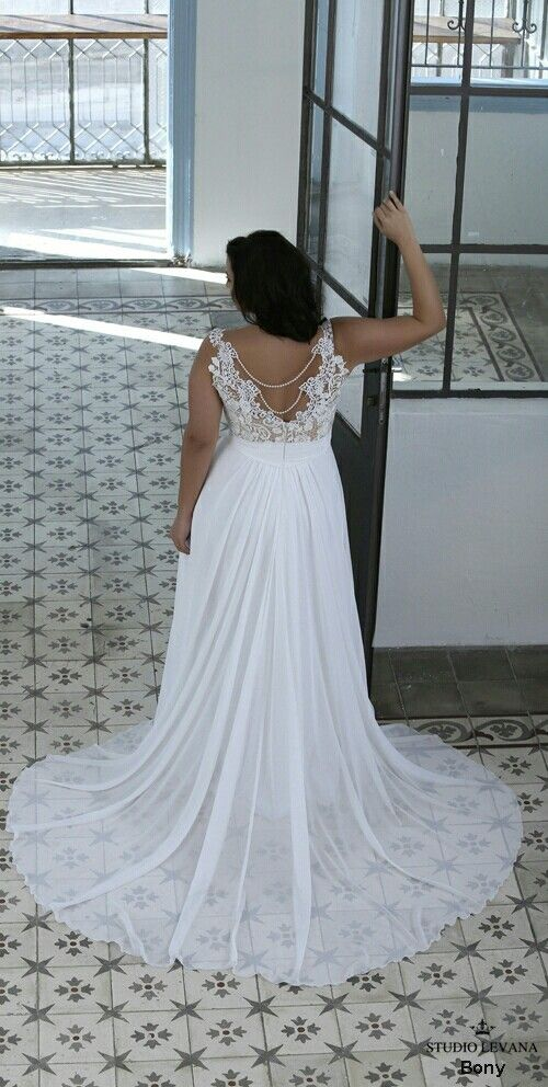 This back on the plus size bridal gown Bonny makes our jaw drop