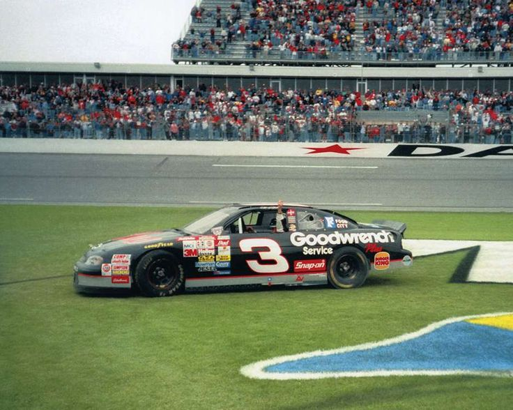 Dale Earnhardt performs a celebratory slide through the grass after winning the 1998 Daytona 500 and exorcising his demons of Daytona 500s past.
