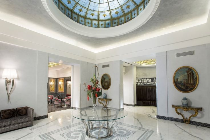 Clean and Modern look with an elegant touch of history. Artemide Hotel Rome