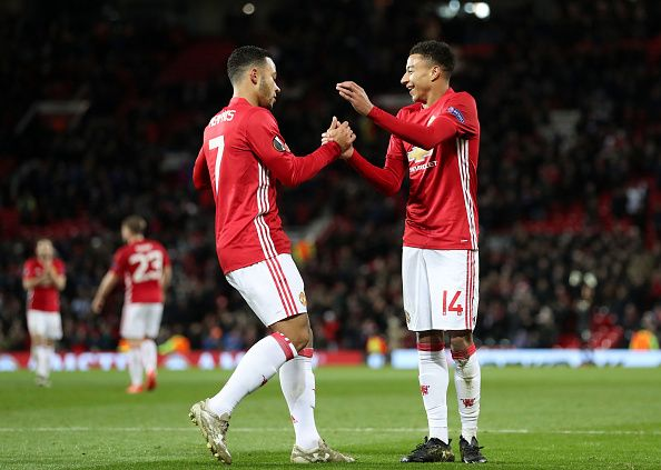 Manchester United's Jesse Lingard celebrates scoring his side's fourth goal of the game with teammate Memphis Depay during the UEFA Europa League...
