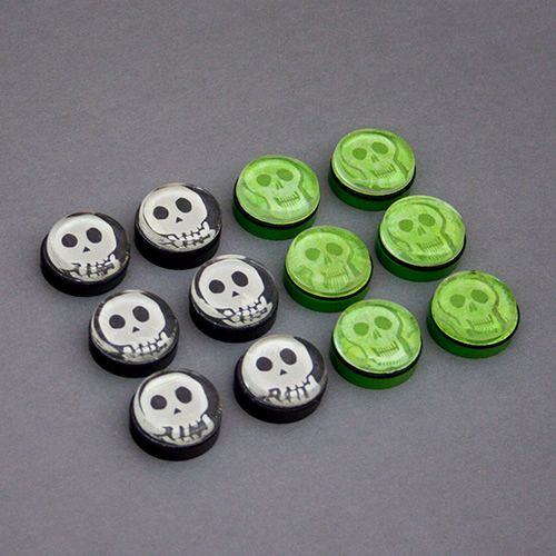 """Skeleton Tokens made with Alea Tools 1"""" Miniature Conversion Circles, 1"""" flat glass disks, and spare scrapbook paper."""