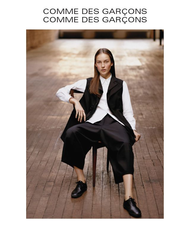 COMME DES GARÇONS COMME DES GARÇONS  Wool double-collar vest in black. $1355. Cotton long-sleeve dress shirt with ruffle in white. $450. Wool seamed culotte in black. $415.