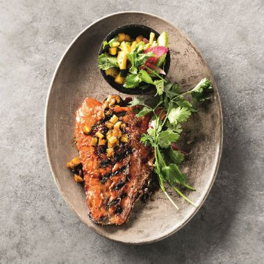 Pineapple grilled trout with a mango and lime salsa