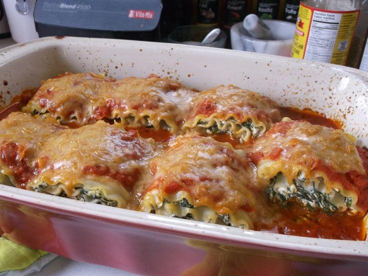 Lasagna rollups with tofu ricotta and spinach filling, marinara sauce and smoked Gouda vegan cheese