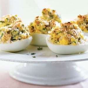 French-Style Stuffed Eggs Recipe  At only 38 calories per half, you can eat two servings of this delicious take on deviled eggs and still come out under 80 calories. Studded with bits of chopped ham and fresh herbs, these are equally appealing served cold without the broiled crumb topping.