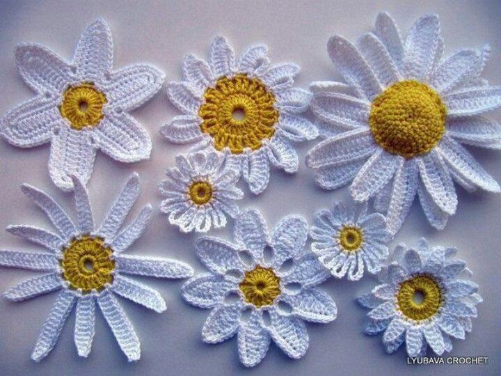 crochet daisiesI ooh ooh iv just had an idea for a blanket with different style and size Daisy's one in each square ♡