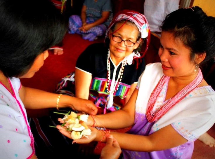 Karen Wrist Tying Ceremony on 1 September 2012.     Once a year Karen people gather together for the ceremony where the elders tying white thread to the wrists and give blessing to show and remember that they are one. During this day they share food, dance and celebrate. This tradition is part of the Karen culture and passed on from generation to generation.