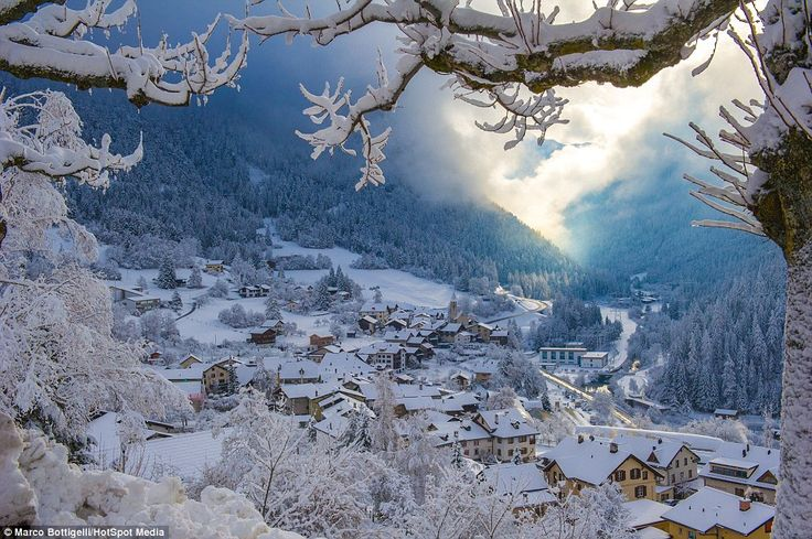 Looking like a scene from a fairy-tale, a snow-dusted Filisur is nestled in a valley surrounded by trees