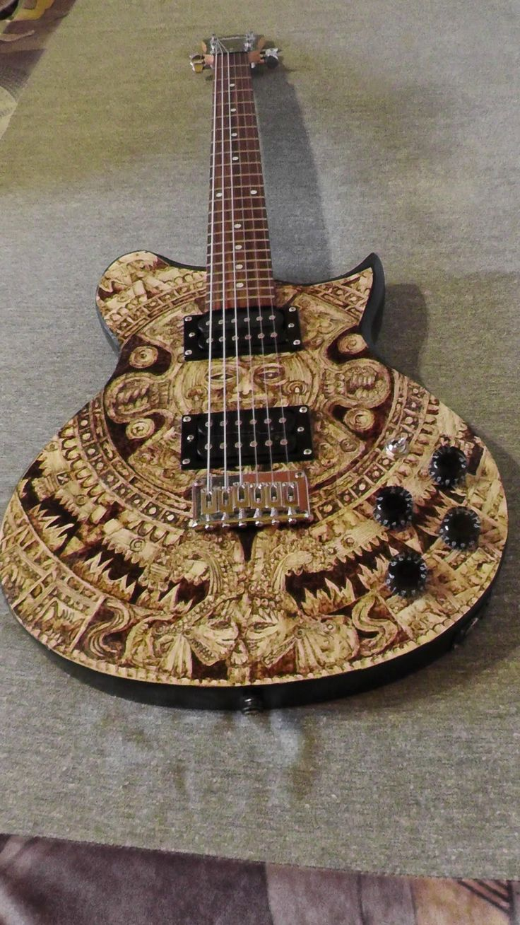 Maya calendar electric guitar, made by Psujek Arts