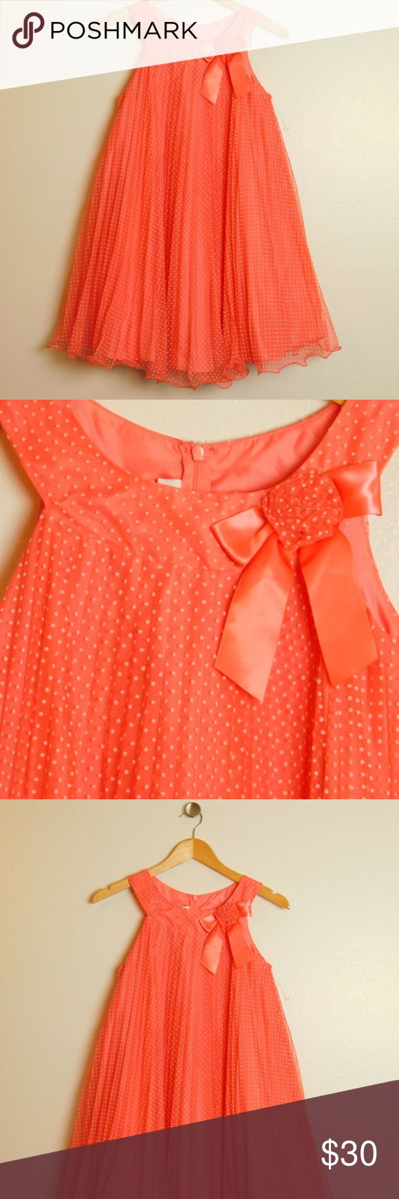 Bonnie Jean Coral Dot Mesh Pleated Dress 12 New NWOT New Without Tags condition Never worn, price tag removed Children's kids size 12 Color:     Coral White Trapeze u-neckline Sleeveless Hidden back zip closure Allover white flocked dot detail Allover pleated mesh overlay Rosette flower with satin bow at neckline Fully lined  Fabric & Care Dress 100% polyester Netting 100% nylon Machine washable Bonnie Jean Dresses