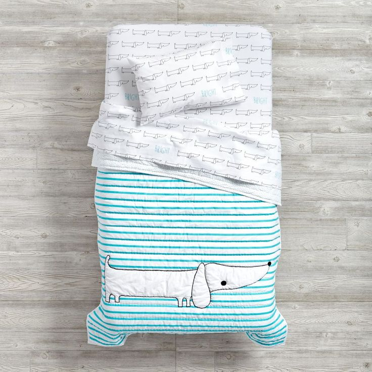 Shop Early Edition Toddler Sheet Set (Dog).  Our Early Edition Toddler Sheet Set (Dog) is adorned with charming playful prints of animals, words, dots or stripes.  Shop baby bedding today.