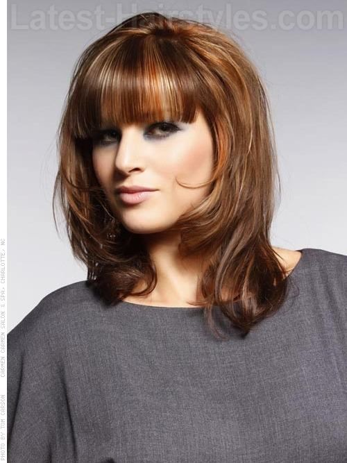 medium cut hair style strictly bangs highlighted medium cut with bangs 5692 | 4d6d894082ba689eb8e5907b86ad3dd1