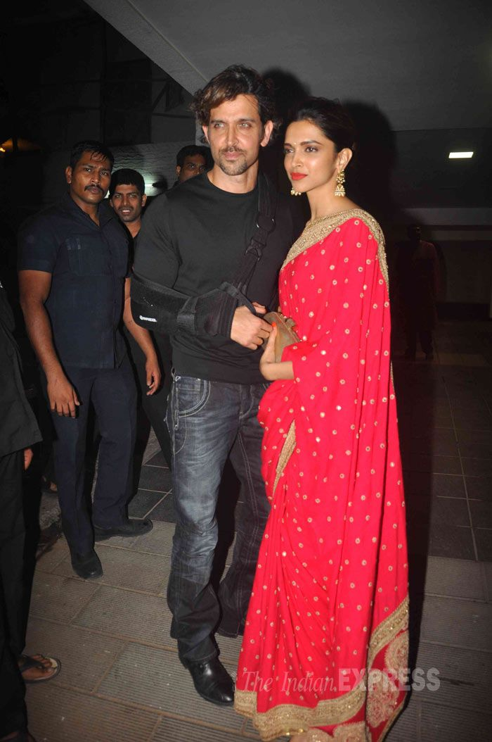 Deepika Padukone looked stunning in a rich red and gold sari as she posed for a picture along with Hrithik Roshan, who is nursing a hand injury at Aamir Khan's Diwali bash.
