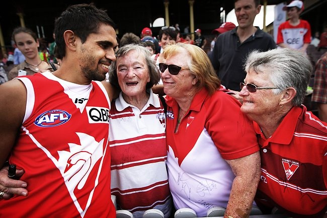 Lewis Jetta with fans Dawn Caiton, Elsie Murphy and Shirley Howell - Swans fans interact with Swans players at The Sydney Cricket Ground prior to this weekend's AFL Grand Final in Melbourne. Picture: Craig Greenhill