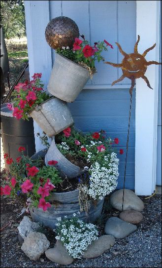 tipsy galvanized bucket planter using rebar or make into water fountain planter
