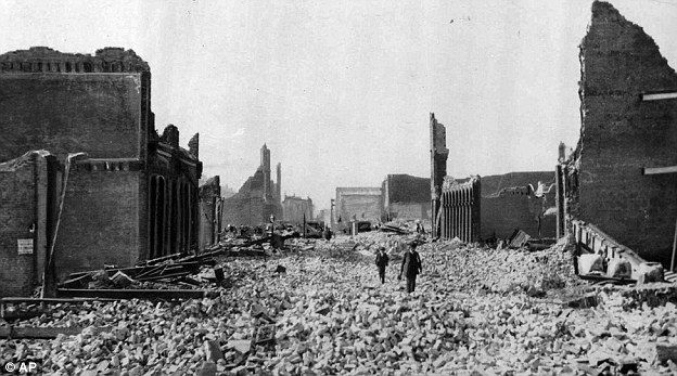 People walk through the rubble following an earthquake in San Francisco on April 18, 1906. On April 17, 1906, San Francisco was cosmopolitan enough to host Enrico Caruso in 'Carmen' and so financially flushed it ranked fourth among American cities in raising money to help victims of a volcano in Italy.  A day later, San Francisco was pleading for help itself after a giant earthquake struck along the San Andreas fault
