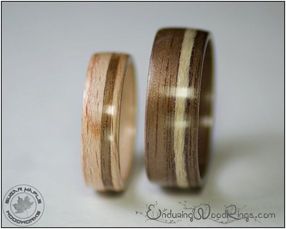 """""""A pair of bentwood rings made from American Beech and American Walnut - two trees that are native to North America. Each ring has a piece of the other inlayed into it."""""""