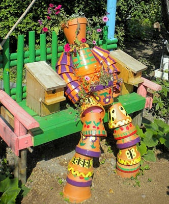I aspire to create one some day.: Terra Cotta, Flower Pots, Clay Flower, Craft Ideas, Pot People, Garden, Pot Person, Clay Pots