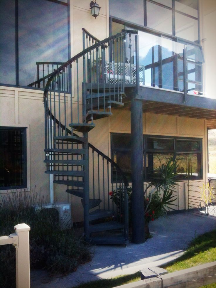 Spiral staircase but replace the handrail and barrier with cedar batons on outside with handrail on inside of cedar batons