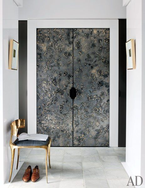 Resin and metal doors by Based Upon, chair by Paul Mathieu and marble floor by Paris Ceramics.